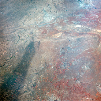Climate of Texas - This image of Texas, obtained by astronauts aboard NASA's Gemini 4 spacecraft shows a large dark swath attributed to rainfall.