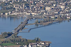Seedamm - The causeway built in 1878 towards Rapperswil, the wooden bridge to the right, Hurden in the foreground.
