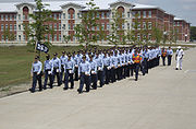 "Recruits march from their ""ship"" barracks named for USS Chicago."