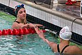 Regan Smith extends her hand to Kylie Masse after winning 100m backstroke (27900746977).jpg