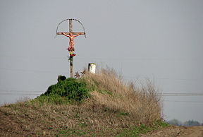 Remains of an old earth mound with a cross (detail).jpg