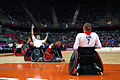 Retired U.S. Sailor William Groulx, center, the U.S. wheelchair rugby team captain, plays defense against a Great Britain player during a match at the Paralympic Games in London Sept 120905-A-SR101-2277.jpg