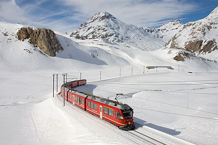 "RhB ABe 8/12 ""Allegra"" multiple unit with a local train to Tirano in the grade between Bernina Lagalb and Ospizio Bernina."