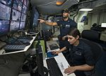 Sailors monitor USS Carl Vinson video feed from the security dispatch station. (30965565206).jpg