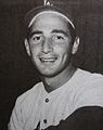 A black-and-white picture of Sandy Koufax smiling in a Los Angeles Dodgers uniform.