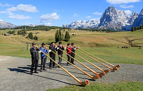 Alphorn blowers at the Sanon hut, Seiser Alm, South Tyrol, Italy.