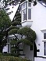 Seven Kings garden with oriel window.jpg