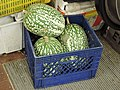 Shark fin melons from the box in the market.jpg