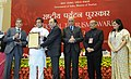 Shashi Tharoor presented the National Tourism Awards, at a function, in New Delhi on February 18, 2014. The Secretary, Ministry of Tourism, Shri Parvez Dewan is also seen (1).jpg