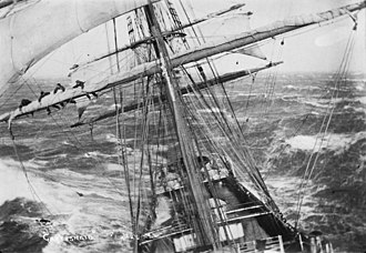 Windjammer - Crew of the ship Garthsnaid at sea, ca. 1920, securing a section of the foresail.