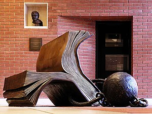 Bill Woodrow - Woodrow's Sitting on History (1995) was purchased for the British Library by Carl Djerassi and Diane Middlebrook in 1997. The sculpture, with its ball and chain, refers to the book as the captor of information from which we cannot escape.