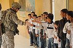 Soldiers, Iraqi national policemen distribute school supplies in Baghdad DVIDS157214.jpg