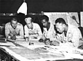 Soldiers from the 24th Infantry Regiment plotting defensive positions on Bougainville in March 1944.jpg