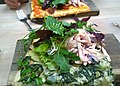 Spinach and potato pizza with salad and coleslaw (20179421791).jpg