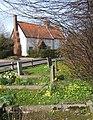 Springtime in Wetherden churchyard, looking across Church Street - geograph.org.uk - 744947.jpg