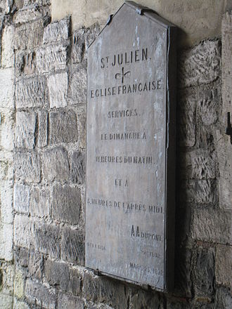 Church of St. Julien, Southampton - Sign on the church giving details (in French) of services. The sign is dated 25 March 1878