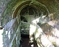 St Peter's Holy Well, Houston, Renfrewshire - fine detail of the internal stonework of this rare covered well.jpg