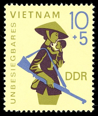 "East German solidarity stamp depicting a Vietnamese mother and child with the text ""Invincible Vietnam"" Stamps of Germany (DDR) 1968, MiNr 1371.jpg"