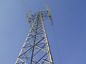 A steel pylon suspending overhead powerlines.