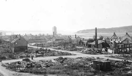 The bombed-out town of Steinkjer Steinkjer after German bombing.jpg