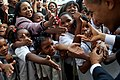 Students hold out their hands to greet President Barack Obama during his visit to Dr. Martin Luther King Jr. Charter School in New Orleans, La., Oct. 15, 2009.jpg