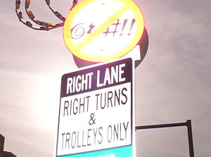 A sign that designates no swearing in a city.