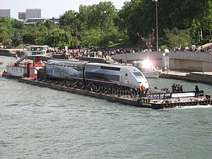 Record-breaking TGV V150 train on a barge on t...