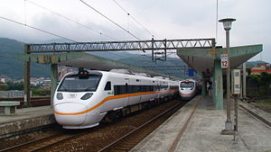 Rail transport in Taiwan - A TRA Taroko Express train stands at Toucheng Station as another pulls alongside