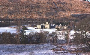 PYTHON - Taymouth Castle, situated in a valley and protected by surrounding hills.