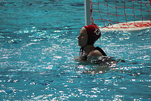 Goalkeeper (water polo) - A water polo goalkeeper with a reserve cap on (FINA rules).