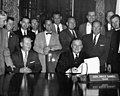 Texas Governor Price Daniel (seated) signing bill making Arlington State College a four-year college (10010616).jpg