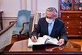 Thai Deputy Prime Minister and Foreign Minister Don Pramudwinai Signs Guestbook (51525204355).jpg