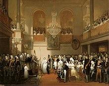 Pictură în ulei reprezentându-i pe Léopold I și Louise d'Orléans la nunta lor, oficialii în spectacol mare sunt numeroși, galeriile de la etajele superioare sunt împachetate, scena este luminată de candelabre impozante din aur și cristal.