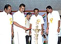 The Minister for Industries, Tamil Nadu, Shri S.P. Velumani lighting the lamp to inaugurate the Bharat Nirman Public Information Campaign, at Pollachi in Coimbatore district, Tamil Nadu on August 27, 2011.jpg