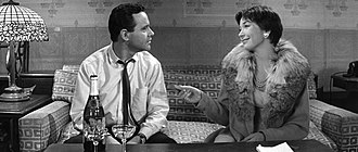 "The Apartment - Calvin Clifford ""Bud"" Baxter (Jack Lemmon) and Fran Kubelik (Shirley MacLaine), in a still from the film's final scene: ""Shut up and deal."""