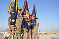The flag of the 5th Infantry Regiment, center, is flanked by the flags of the regiment's 1st and 2nd battalions during an unveiling ceremony at Forward Operating Base Shoja, in Kandahar province, Afghanistan 120214-A-BR342-286.jpg