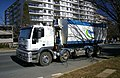 Thiess Services hooklift compactor bin on an Iveco 4500.jpg