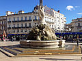 Three Graces fountain on the Place de la Comédie and tramway Line 1 11 2013 Montpellier 614.JPG