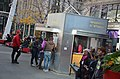 Ticketing booth for our tour bus on Dundas Square, Toronto (27287206313).jpg