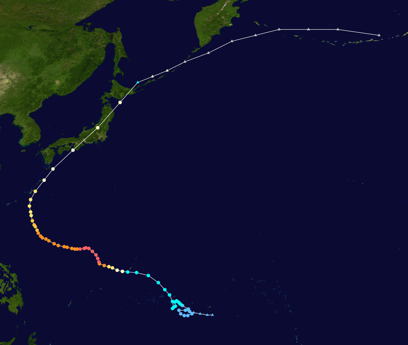 Satellite image of the path of the typhoon. It starts in the Pacific Ocean east of the Philippines, arcs through Japan, and ends near the Aleutian Islands.
