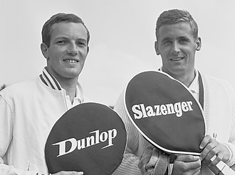 Dunlop Rubber - Dutch tennis players Tom Okker and Jan Hajer pose with Dunlop and Slazenger rackets in 1964