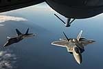 Two F-22 Raptors fly behind a KC-135 Stratotanker over the Baltic Sea - 150904-F-XT249-180.jpg