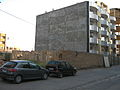 Two car parked near wall - near amin al-Islami garden 1.JPG