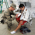 U.S. Air Force 2nd Lt. Matthew Keelin, left, a doctor assigned to the Chemical, Biological, Radiological, Nuclear and high-yield Explosives Enhanced Response Force Package, Oregon Air National Guard, examines 140327-Z-CH590-269.jpg