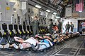 U.S. Air Force Capt. Rita O'Brian, standing left, a flight nurse with the 139th Aeromedical Evacuation Squadron, New York Air National Guard, waits for instructions on moving simulated patients out of the cargo 130601-Z-GJ424-034.jpg