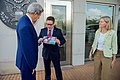 U.S. Embassy Kigali Deputy Chief of Mission Roth Shows Secretary Kerry a Photo of His Family (29696522084).jpg