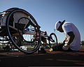 U.S. Marine Corps Sgt. Anthony McDaniel fixes his wheelchair during track practice at the 2013 All-Marine Warrior Games team training camp at Fort Carson in Colorado Springs, Colo., May 4, 2013 130504-M-SO412-193.jpg