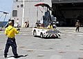 U.S. Navy Aviation Boatswain's Mate Handling 3rd Class Hannah Marihugh receives directions while moving an AH-1N Cobra helicopter on the flight deck of amphibious transport dock ship USS New York (LPD 21) during 120413-N-XK513-077.jpg