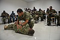 U.S. Navy Chief Petty Officer Charles H. Johnson, center, a maritime interdiction operations expert, demonstrates to boarding team members from east African nations how to evaluate an injury during a first-aid 131112-N-EZ054-146.jpg