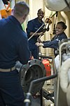 U.S. Sailors move propulsion equipment into a machinery room during maintenance activities aboard the guided missile destroyer USS Arleigh Burke (DDG 51) March 8, 2014, in Marseille, France 140308-N-WD757-102.jpg